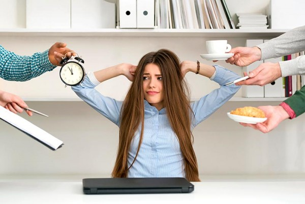 Photo of woman overwhelmed at work for the blog post Don't let anxiety run your life by Dr. Susan Spicer, founder of Brainwave Technologies